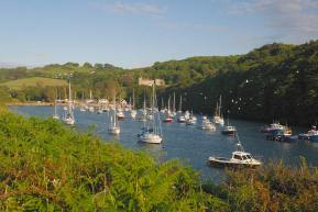 Sailing boats in Watermouth Cove with Watermouth Castle in the background