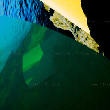 Unevenness 1 (www.blairthomson.com) photograph with sea, reflection of it in some strange surface, blue green and yellow