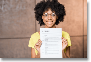 Woman holding up her resume and smiling