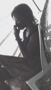 Hurt girl sitting at marina resort
