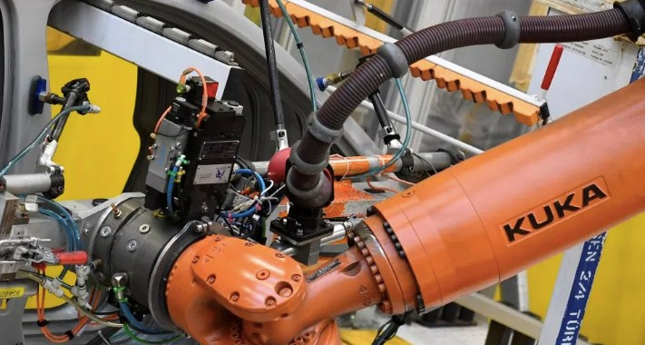 Robots kill jobs. But they create jobs, too.