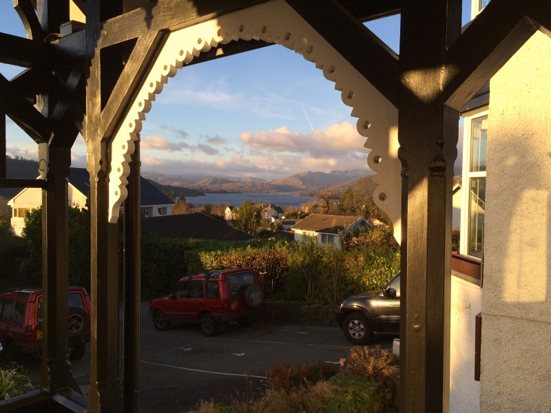 A shot of Old Bowness and Lake Windermere are sweetly framed within the Victorian arches of our 1868 guest house in the Lake District, Blenheim Lodge.