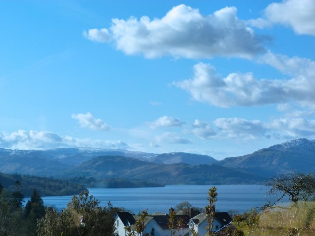 The view from our porch today. The sky was so blue, which was reflected in the waters of Windermere and thence to the mountains.