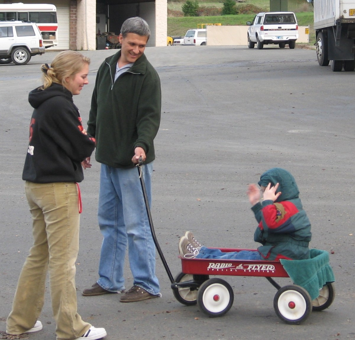 Friends taking Andrew for a 'stroll' in a wagon.