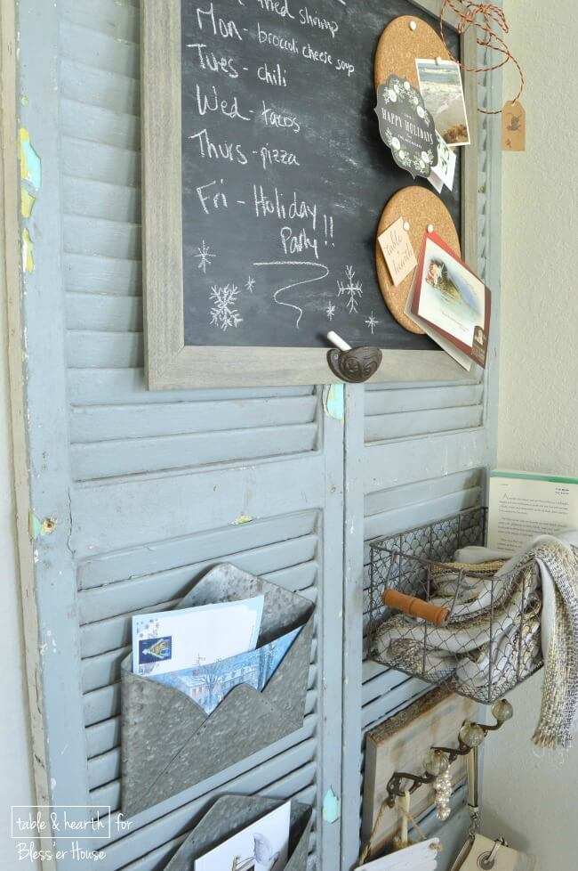 DIY Rustic Shutter Organizer | These worn, weathered, and dirty old shutters were transformed into a cute wall organizer! See the full tutorial at Bless'er House