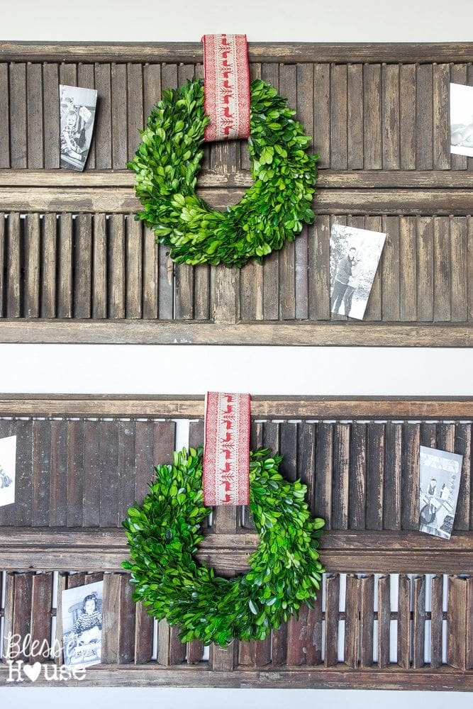 Thrifty Christmas decorating idea: Use shutters to display old photos and Christmas cards between the slats