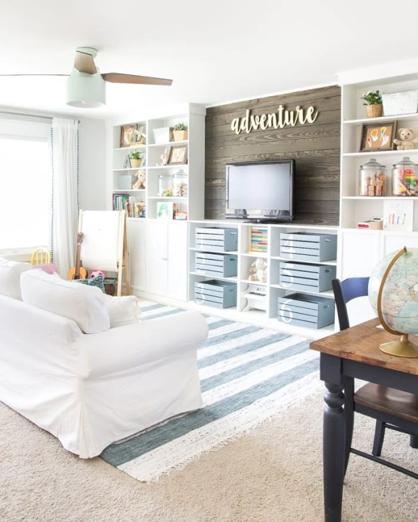 Modern farmhouse playroom with rustic reclaimed accents and DIY built-in shelves | blesserhouse.com - A dated and disorganized playroom gets a fresh, modern, sweet design plan with storage solutions, bright colorful accents, and room to create. #playroom #designboard #moodboard #kidsroom