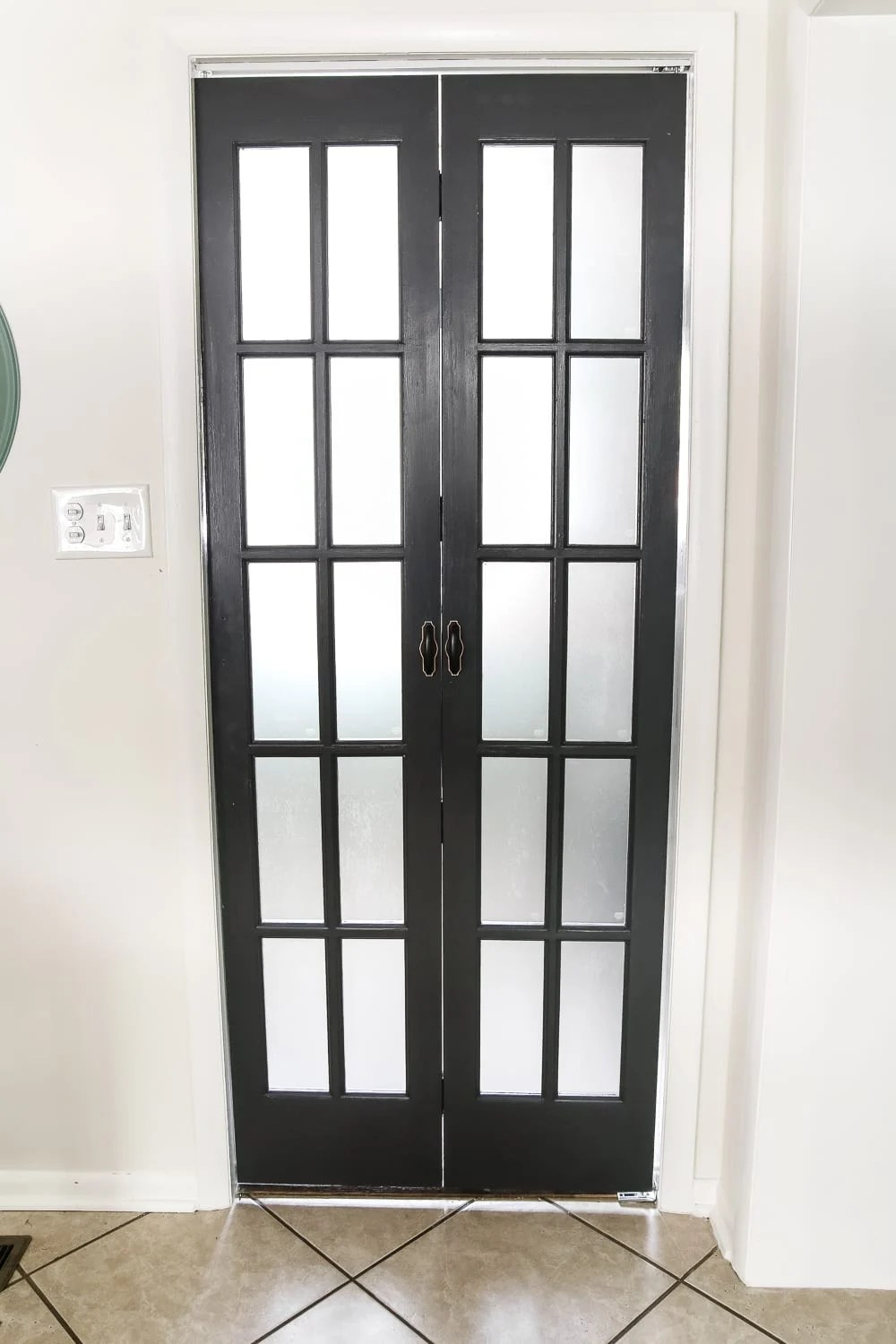 Laundry Room Updates: French Bifold Door | blesserhouse.com - A rickity laundry room bifold door gets a beautiful and functional update with a French bifold door with frosted glass for hiding messes in a stylish way.