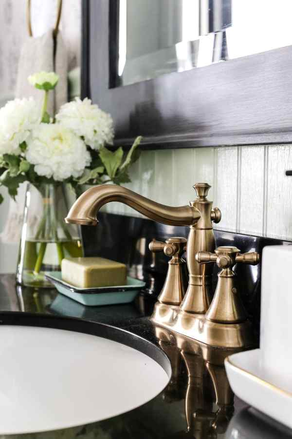 Aqua Meets Urban Powder Room Reveal | blesserhouse.com - A dated powder room gets a modern meets traditional, urban meets farmhouse makeover with aquas, black and white, and antique brass.