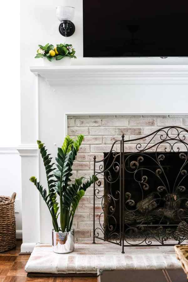 DIY Lime Washed Brick Fireplace | blesserhouse.com - A dirty and tired orange brick fireplace gets a brightened up, weathered lime washed brick makeover, plus a full tutorial to do it yourself.