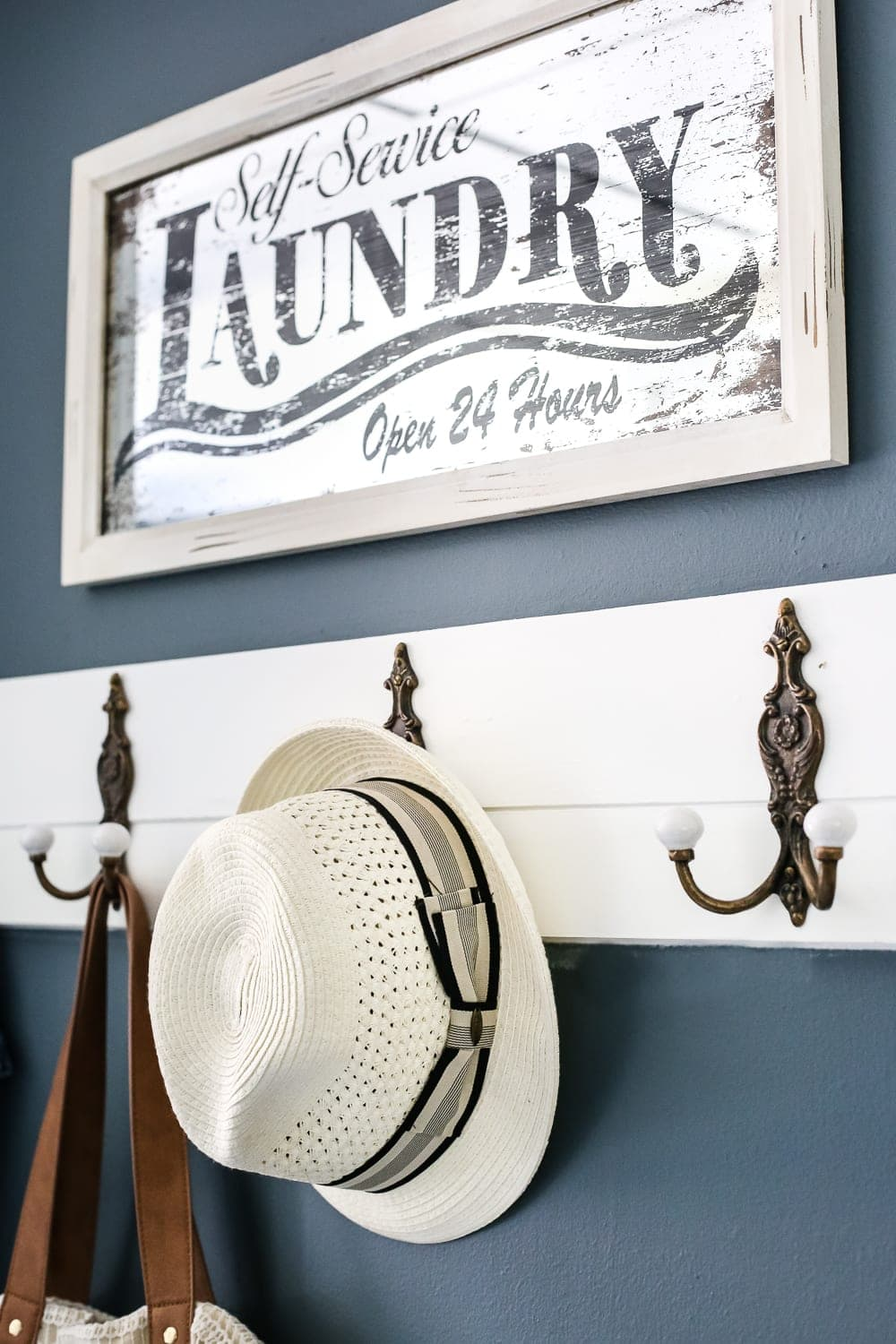 kid-friendly home - hooks for making jackets and hats easy to hang up in a mudroom