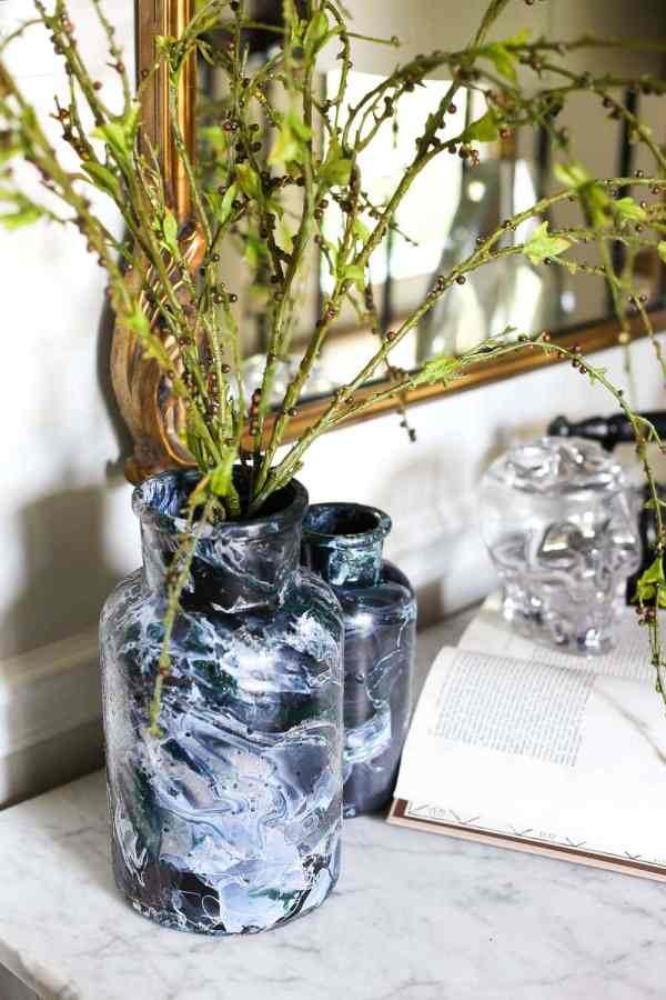 DIY Marbled Vases and Halloween Entryway | blesserhouse.com - A quick tutorial for how to turn old jars and bottles into marbled vases (using nail polish) on the cheap that are modern works of art.