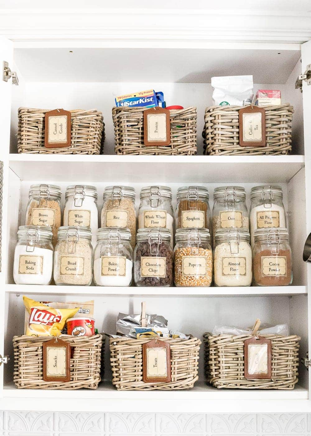 How to Disguise the Ugly Stuff in Your Home | Ditch ingredient packaging and store dry goods in jars with labels instead.