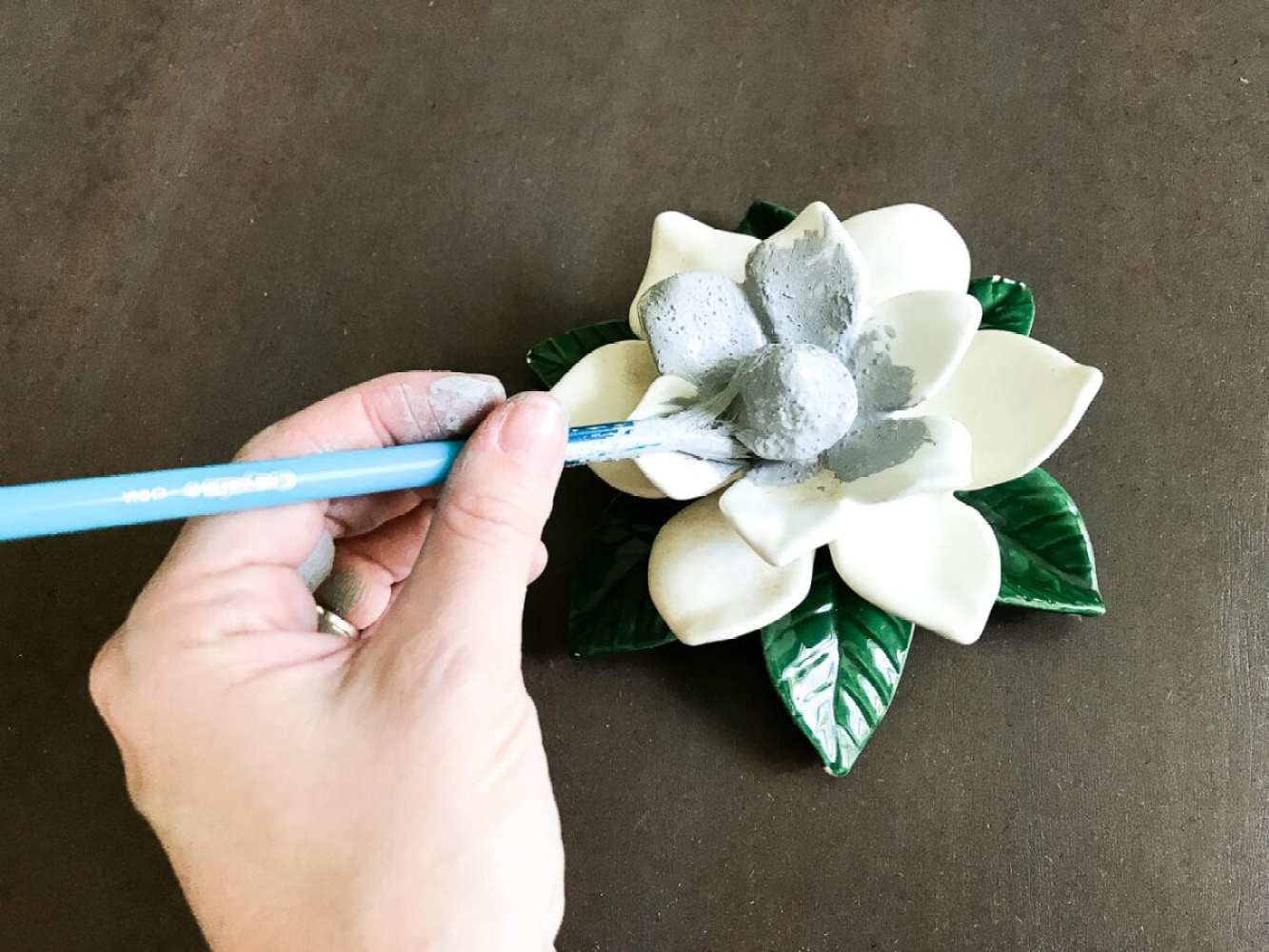 A quick and simple tutorial for how to make anything look like concrete with craft paint. #crafting #painting #thriftydecor