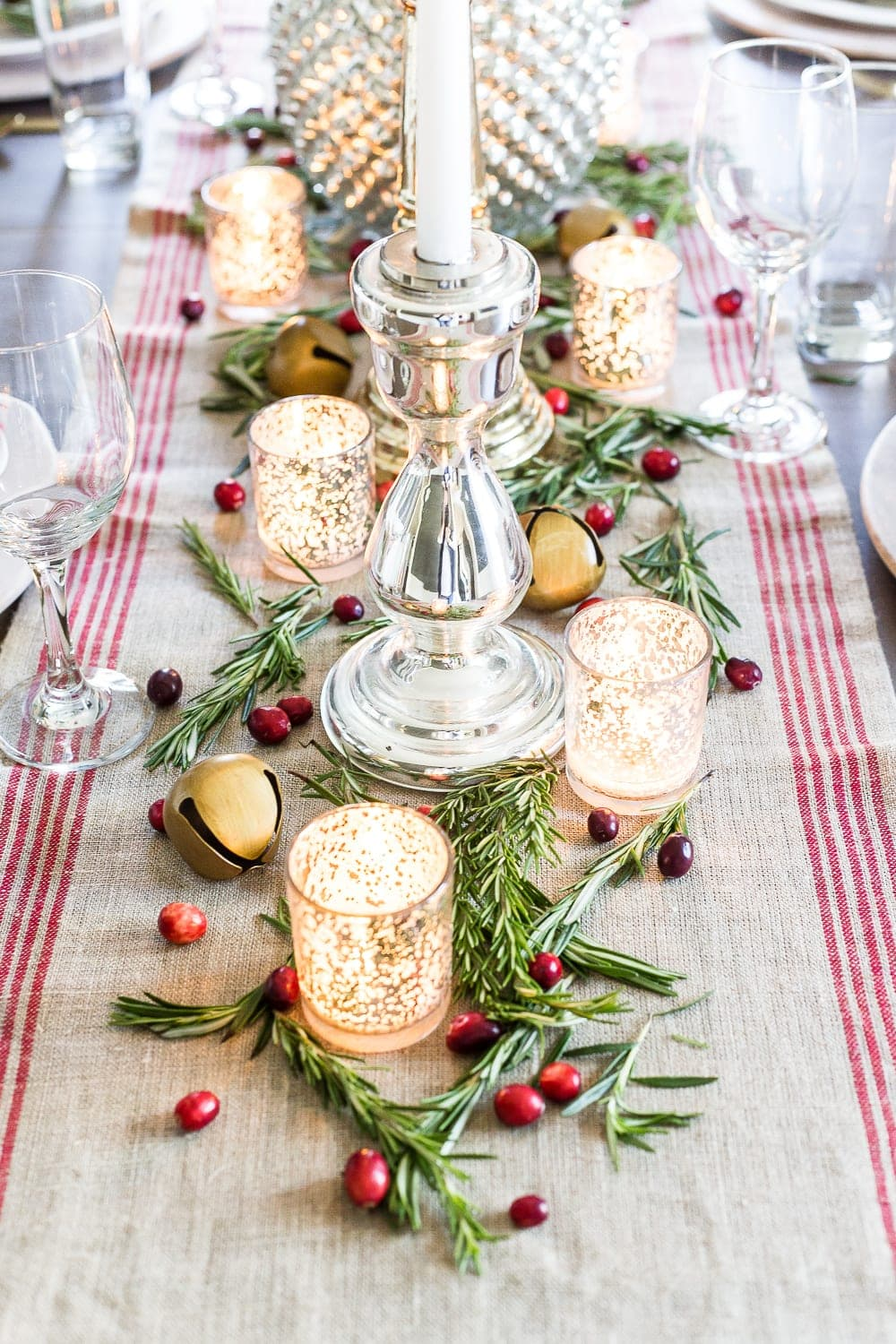 Thrifty Christmas decorating idea: use fresh rosemary and cranberries from the produce aisle to decorate a table
