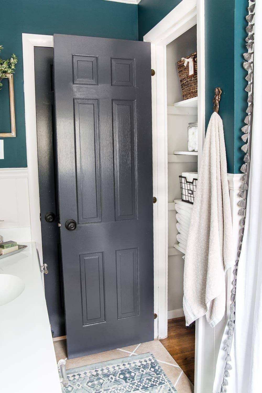 kid-friendly home - black doors for hiding dirty hand prints