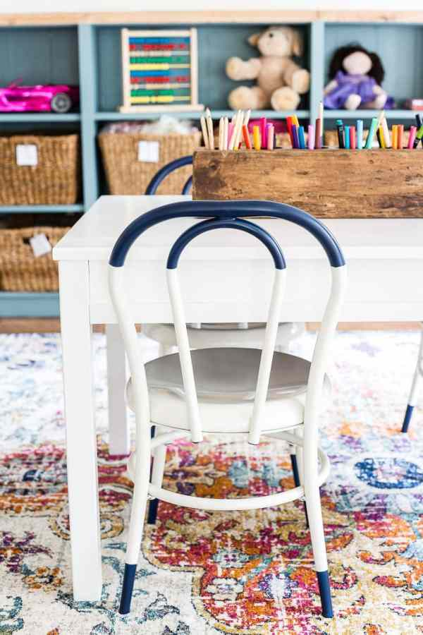 A dated, unorganized playroom gets a bright and whimsical makeover with organizational strategies, ideas for adding function, and DIY-able projects to create the perfect kid's space on a budget. #kidsroom #playroom #kidsdecor #toyorganizing