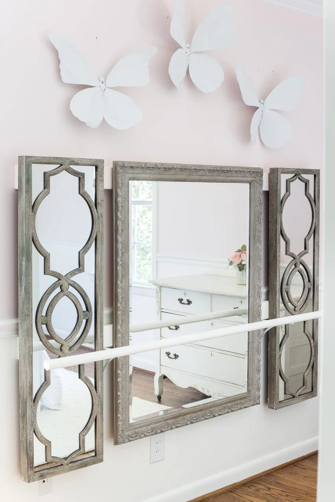 How to make a ballet barre with mirrors and shelf brackets and how to hang wall decor on a chair rail, board and batten, or molding #balletbarre #kidsdecor #girldecor #girlbedroom #girlroom #kidsroom #walldecor #hanginghack #wallhack #diywalldecor