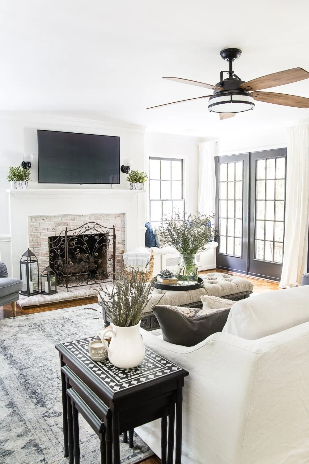 summer living room with limewashed brick fireplace
