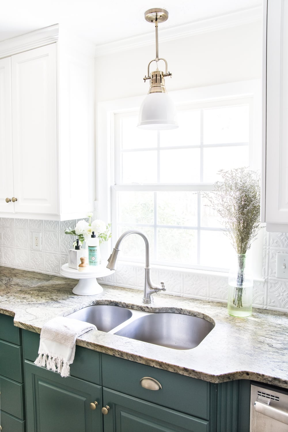 aged brass kitchen pendant light and leathered granite countertops - budget kitchen refresh