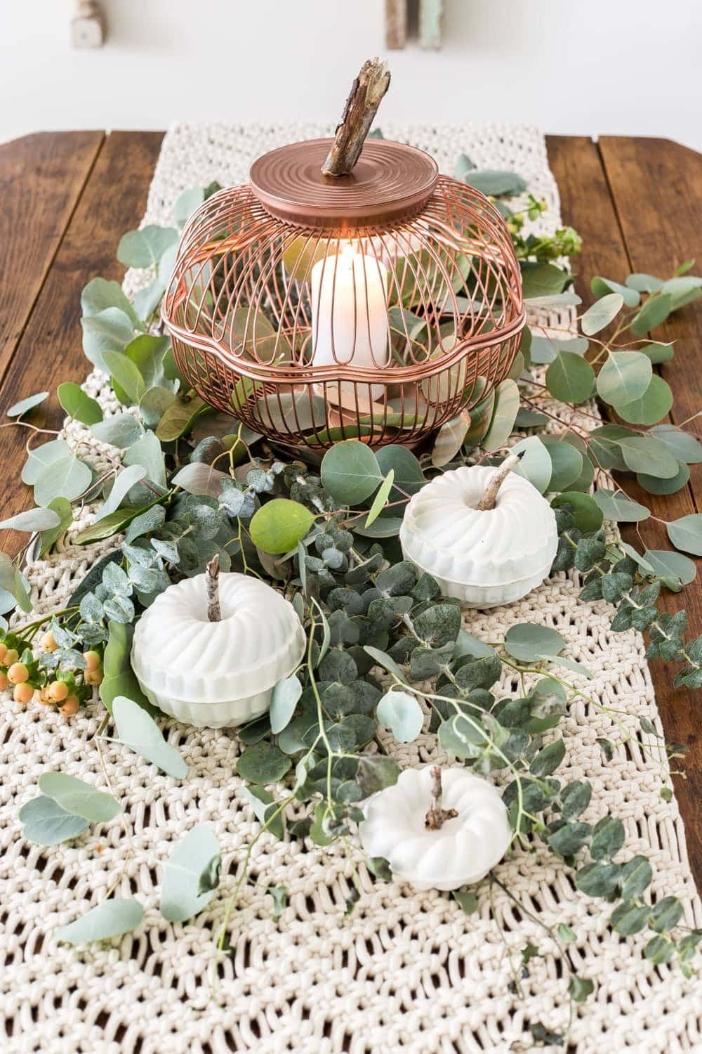 DIY pumpkin lantern using thrifted wire bread baskets and craft pumpkins using mini bundt pan Jello molds