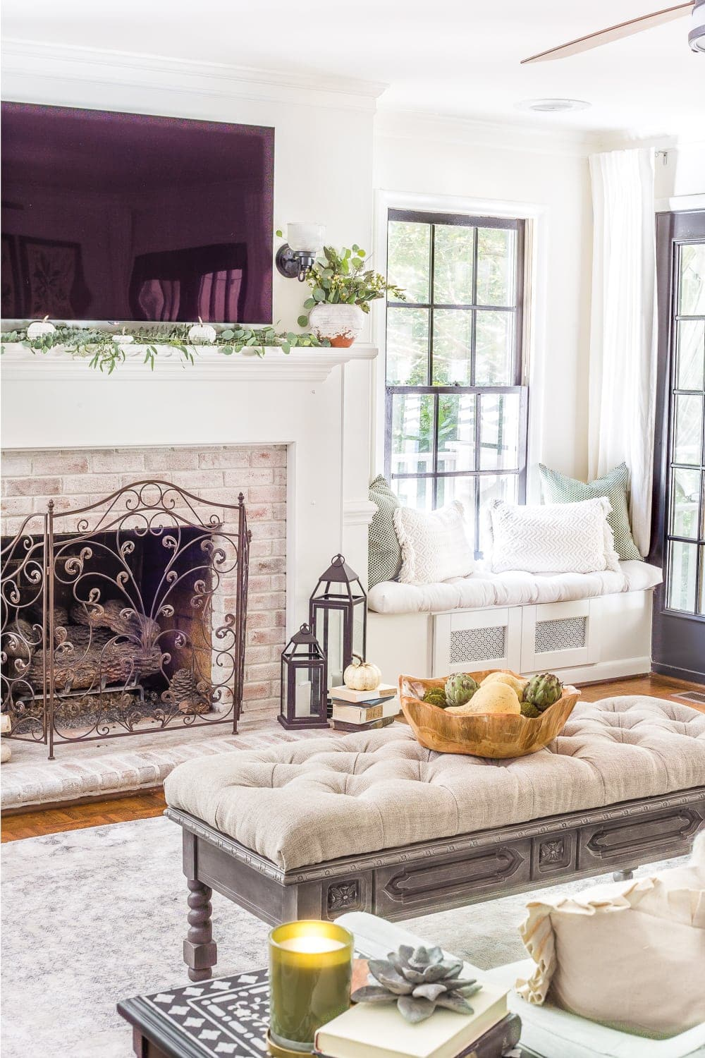 Tips for decorating a neutral fall mantel by reusing classic accents and simple color palette around the obstacle of a TV + 29 more fall mantel decor ideas. #neutralfalldecor #neutralfallmantel #fallmantel #falldecor #neutralfall #falllivingroom #autumndecor #neutralautumn