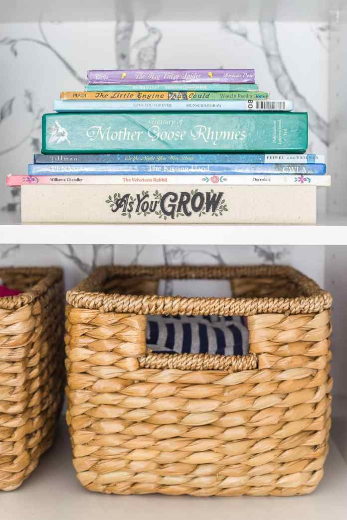 Nursery closet organization with shelving for books