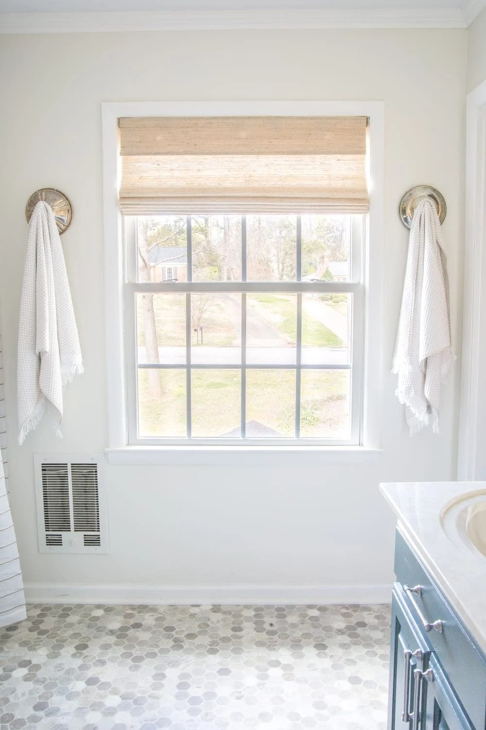 Budget Master Bathroom Refresh Reveal | window shade and sheet vinyl flooring