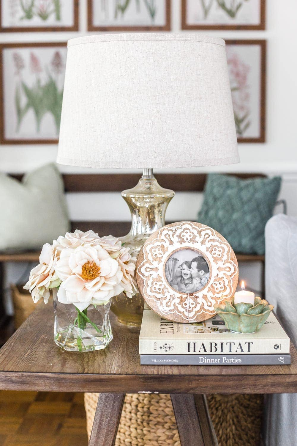 Simple Spring Home Tour | Neutral living room end table with artificial florals and small spring touches.