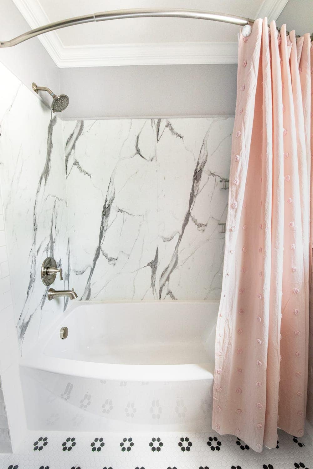 Whimsical, classic kids bathroom makeover | faux marble shower from American Standard Passage Collection and curved tub