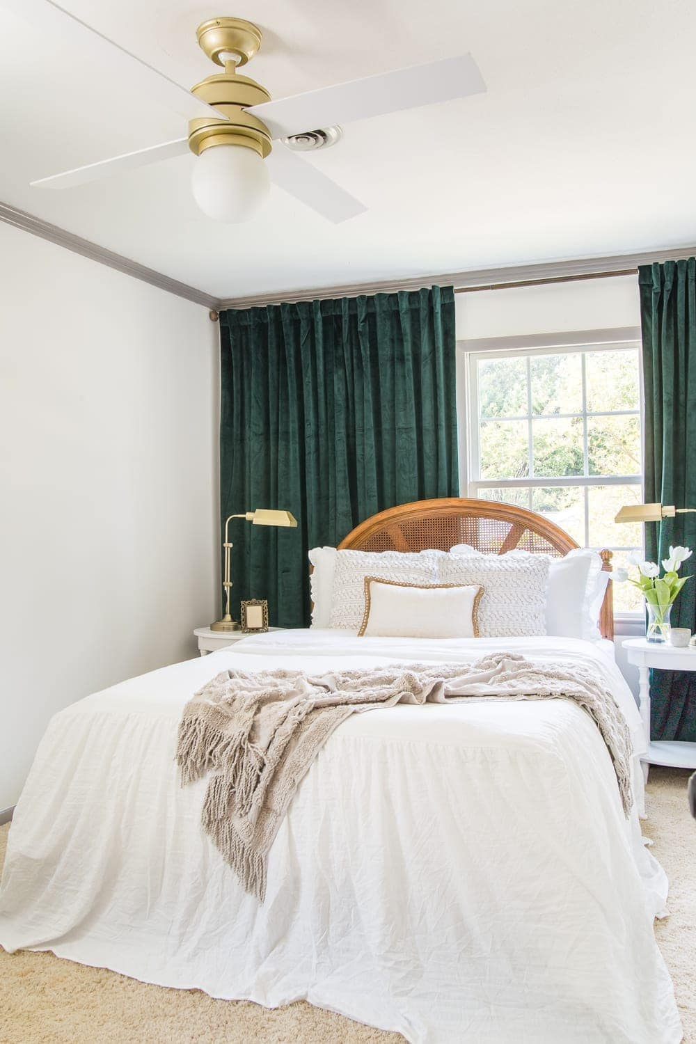 Guest bedroom makeover with linen skirted vintage style bedding and thrifted cane headboard