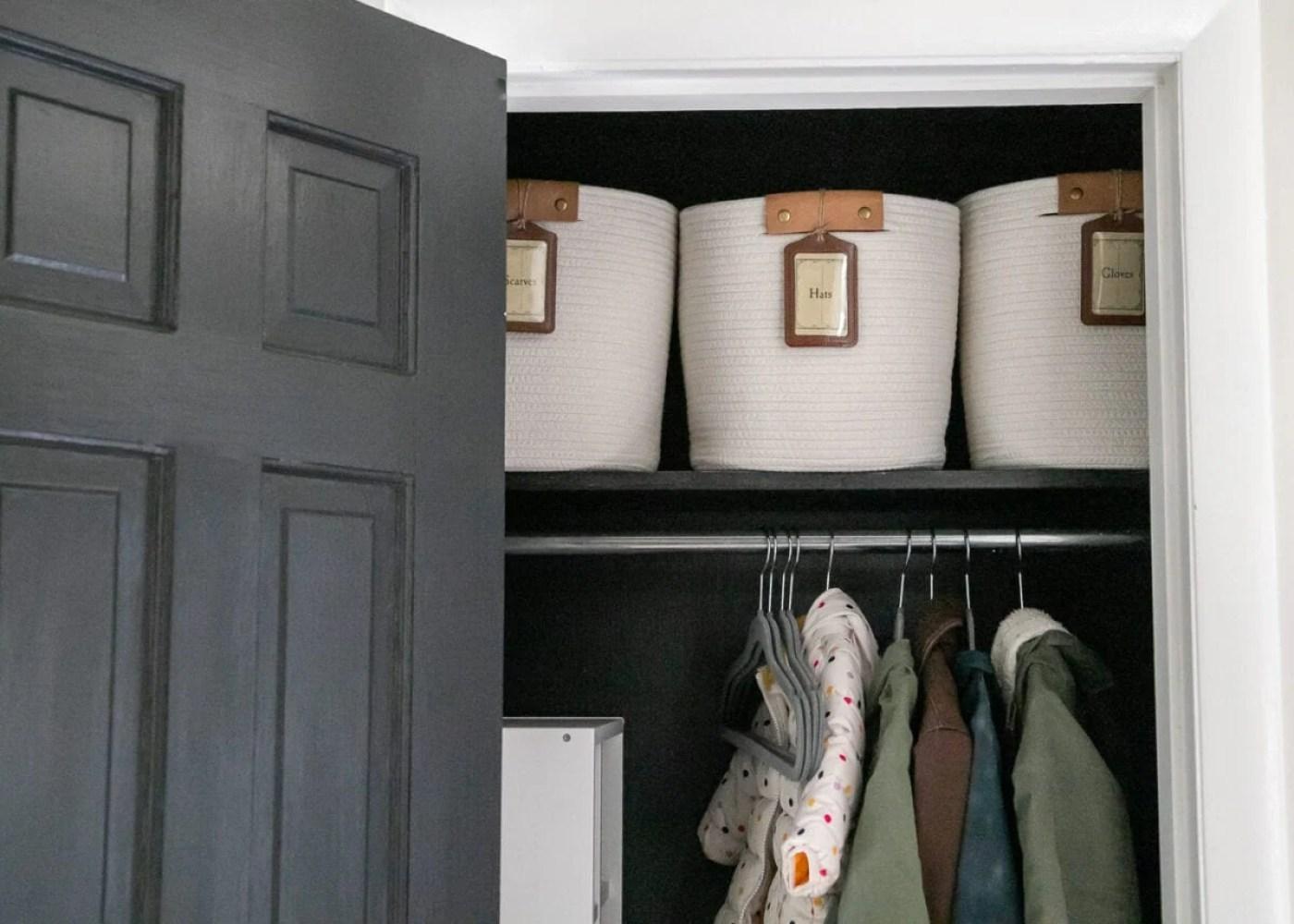 coat closet organization with winter gear bins