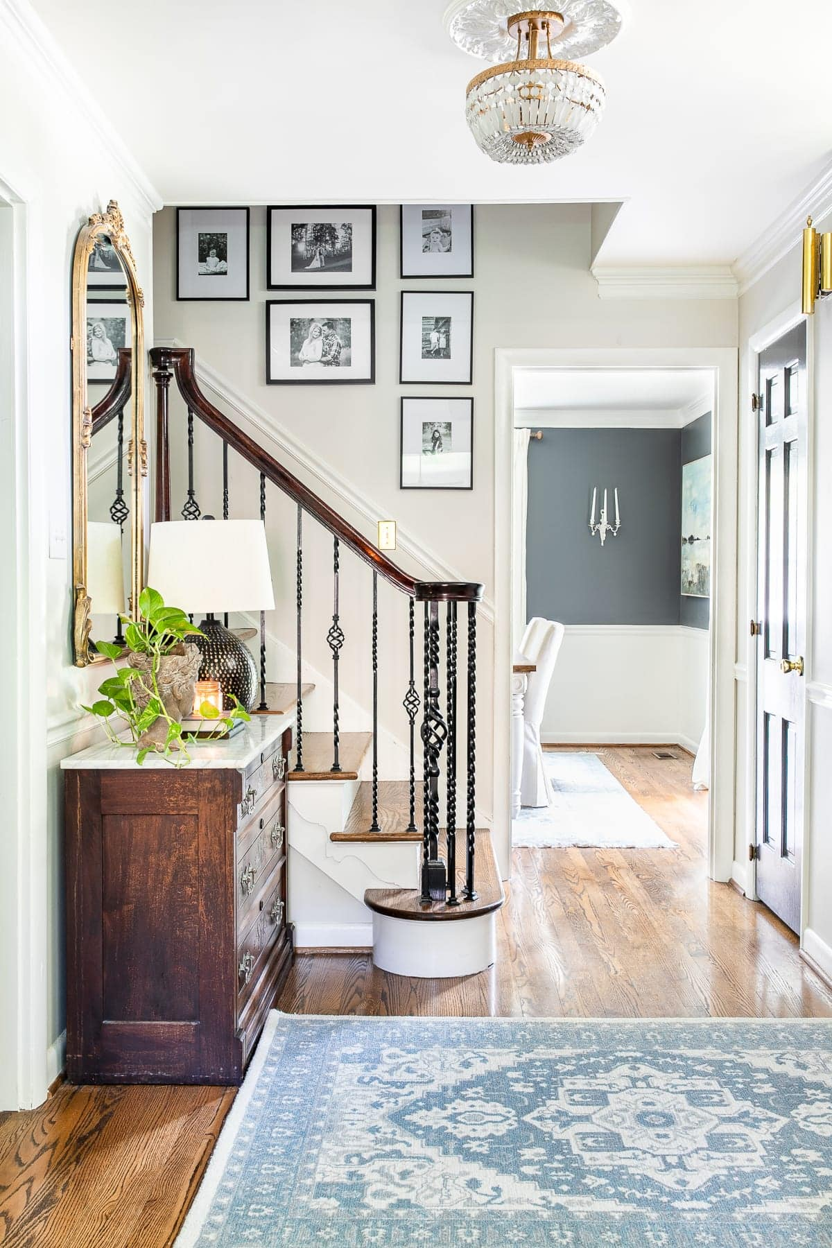 Classic timeless modern foyer with stairway gallery wall