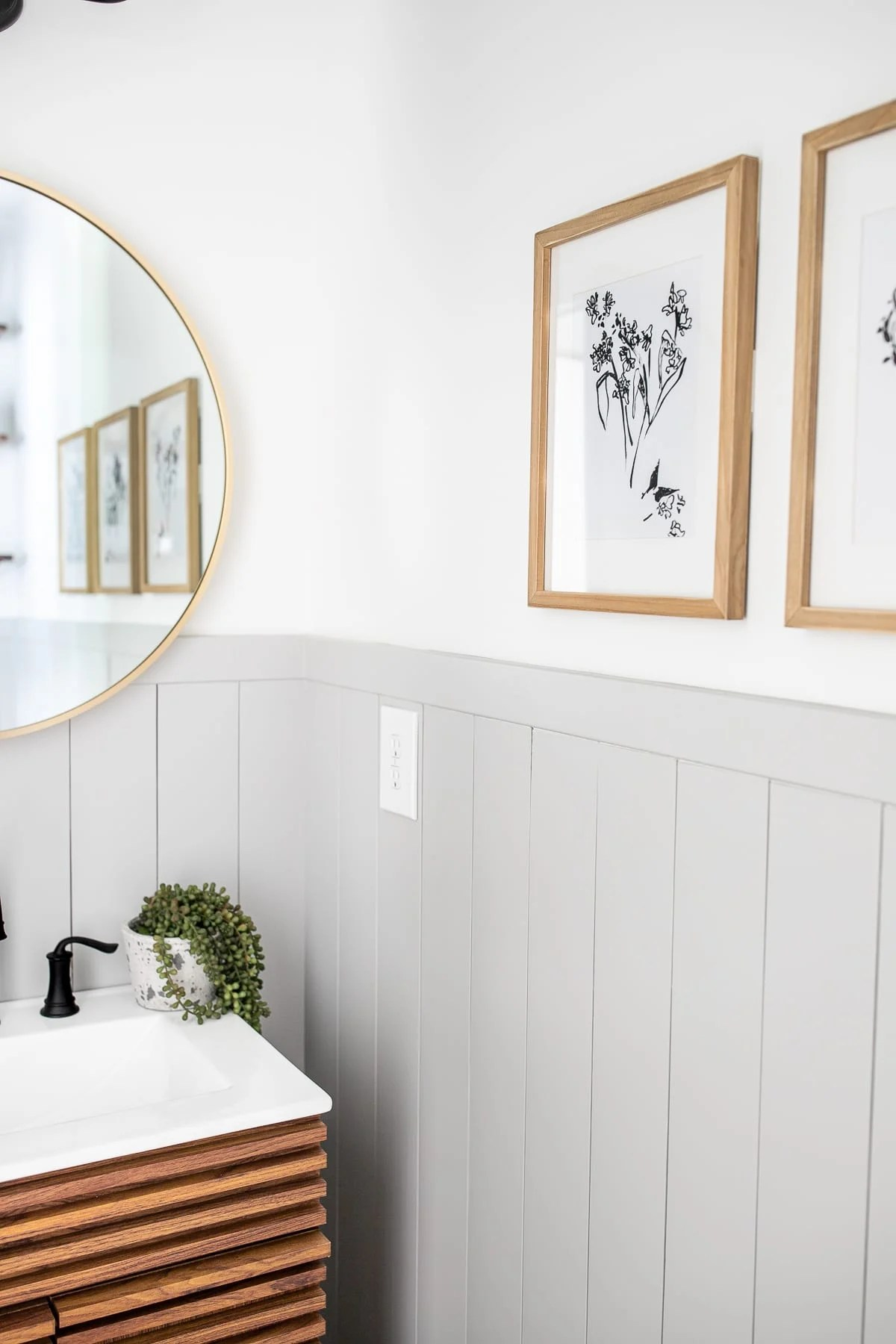 California Casual modern powder room with minimalist botanical art