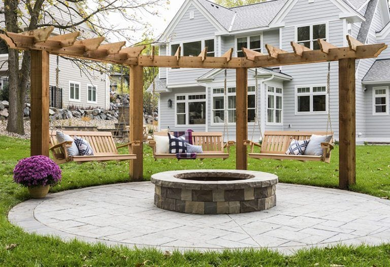 fire pit with swings and pergola