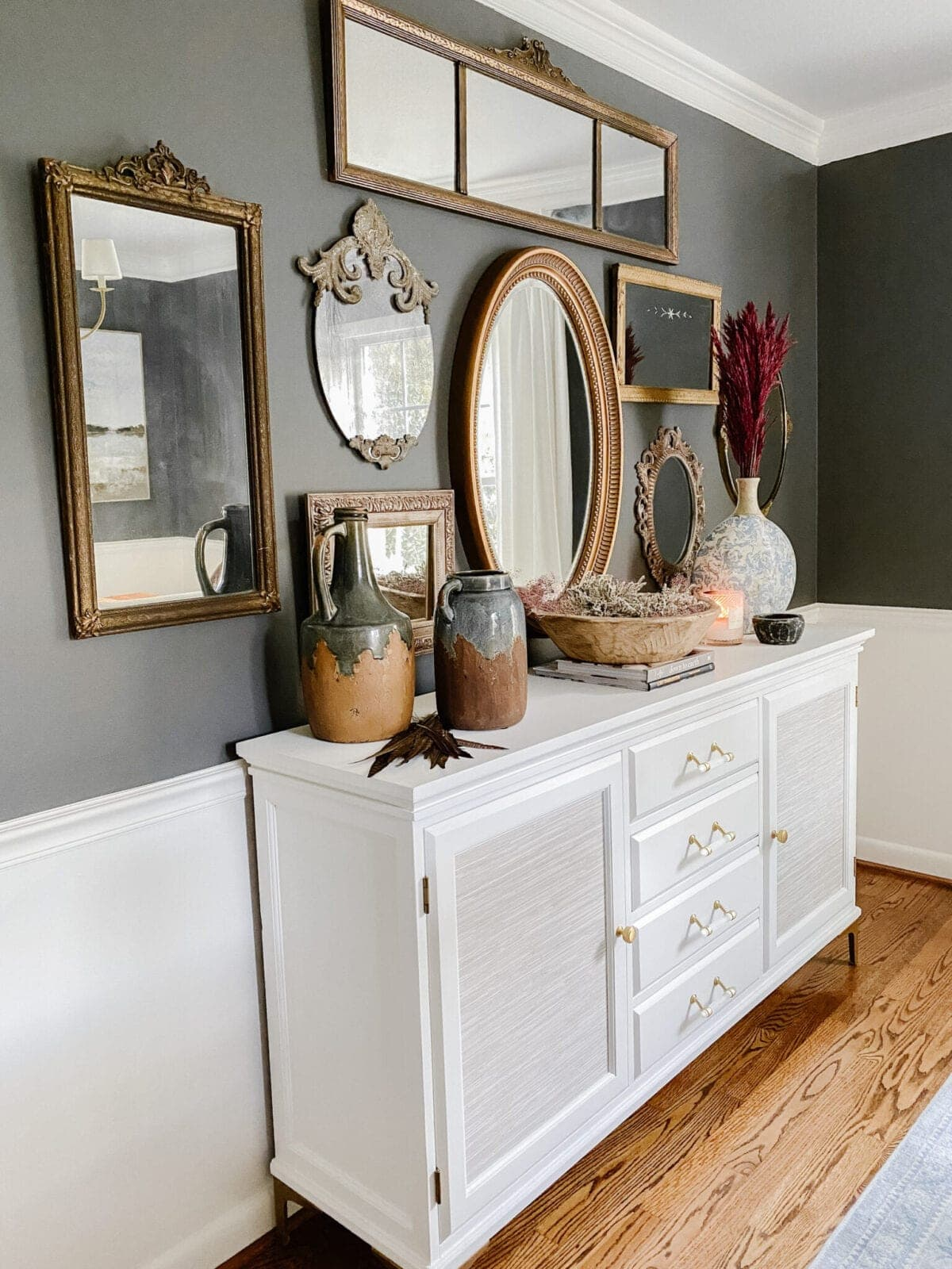 white painted buffet and antique mirror gallery wall