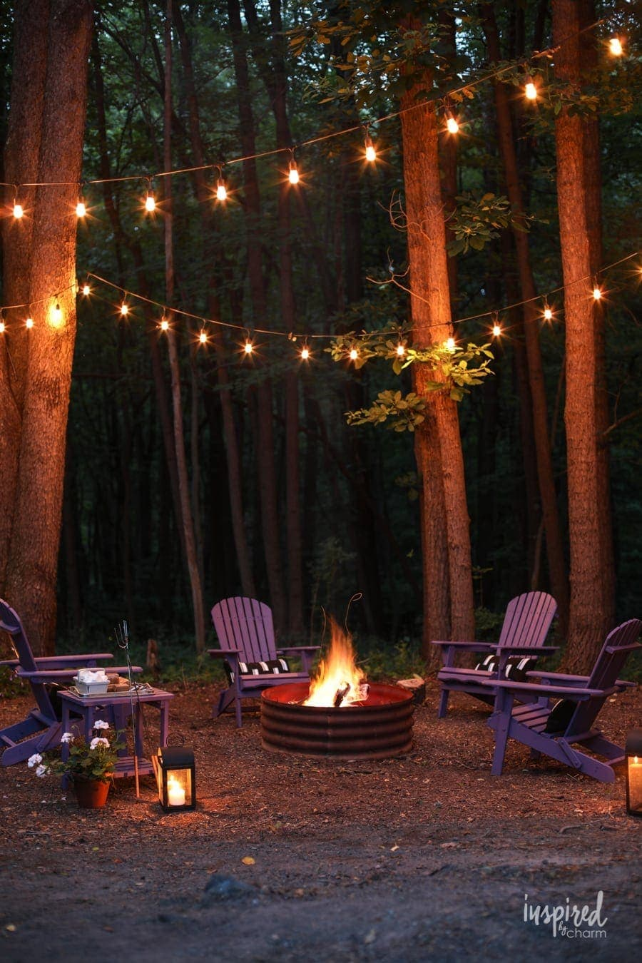 simple fire pit with string lights in trees