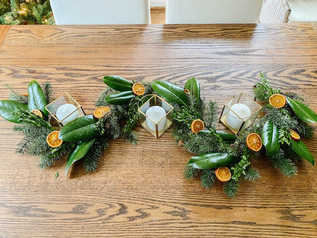 How to make cheap Christmas garland look high-end with magnolia, boxwoods, and dried oranges