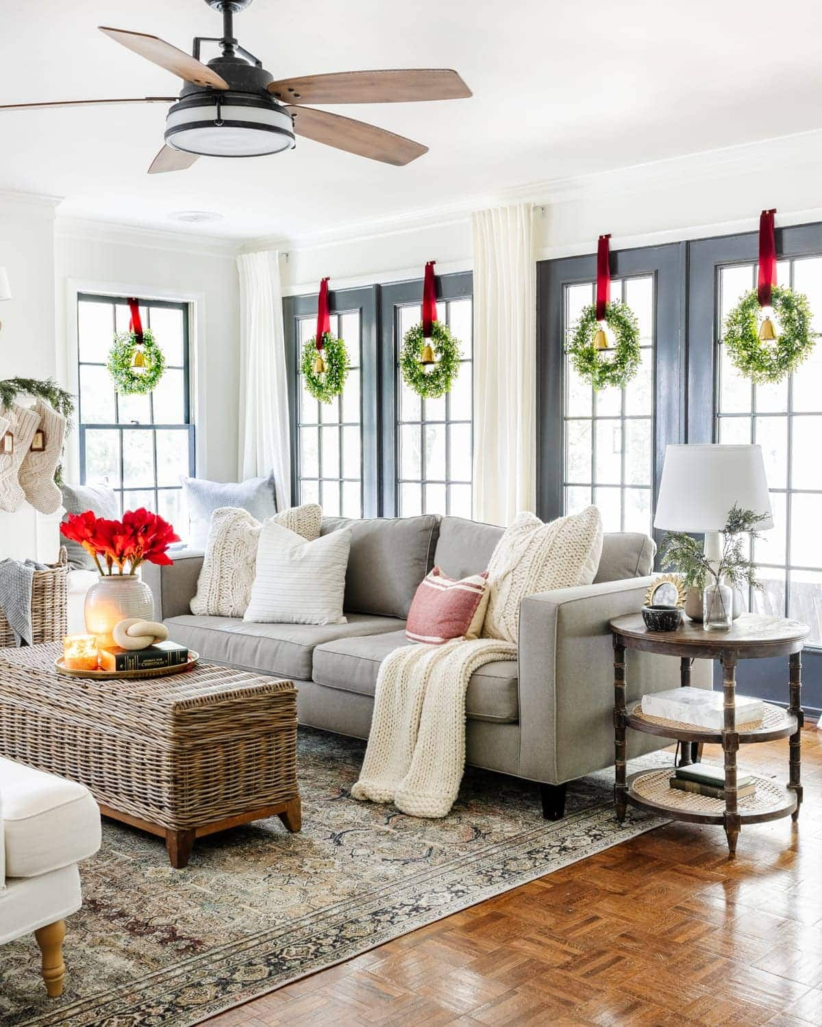 Christmas living room with wreaths hanging on windows