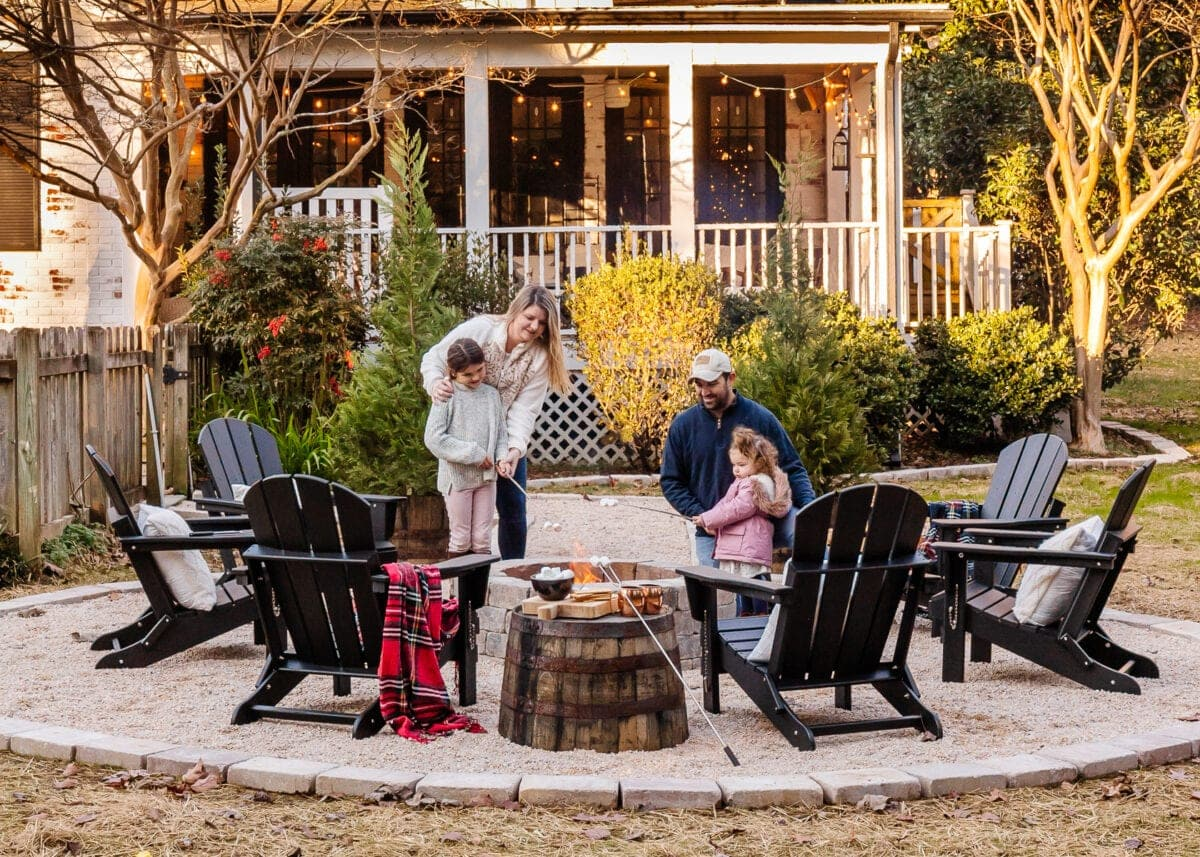 fire pit with pea gravel and adirondack chairs
