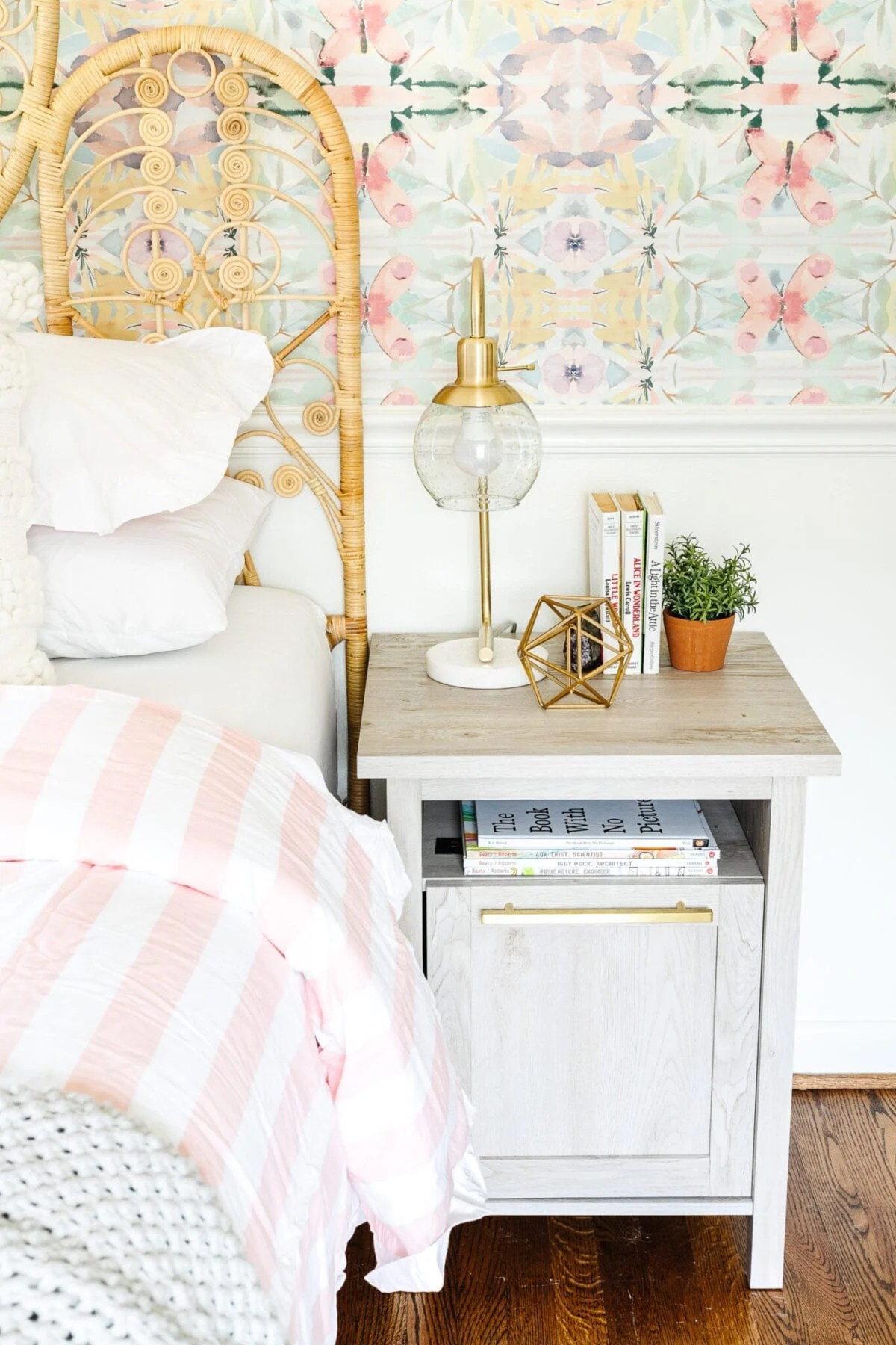 A little girl bedroom gets a big girl update using a few boho furniture swaps, DIY geology art, and glam accents.
