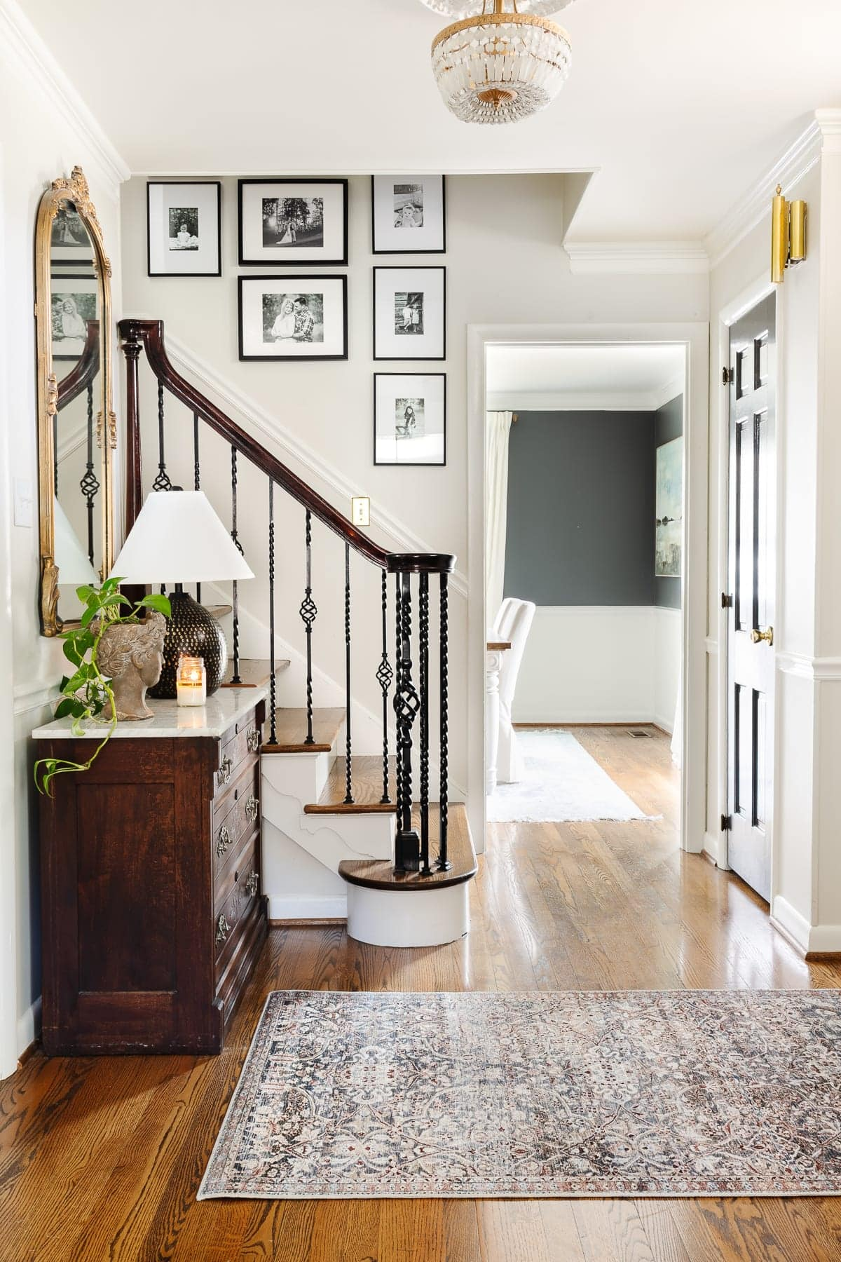 classically decorated foyer with gallery wall on staircase