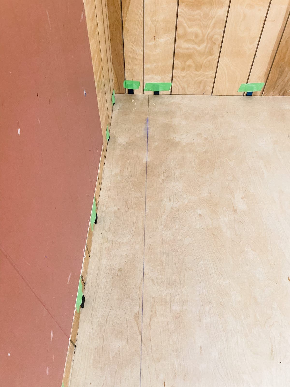 Set a chalk line before installing the first row of luxury vinyl plank flooring to ensure a straight line as the starting point