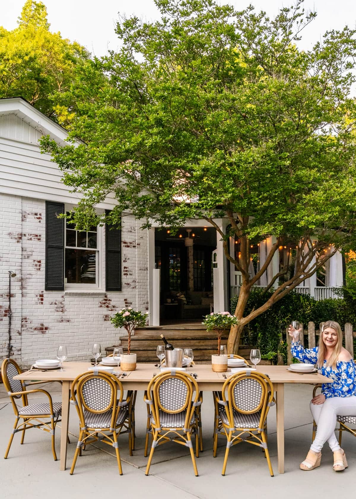 outdoor patio with limewashed brick and dining table