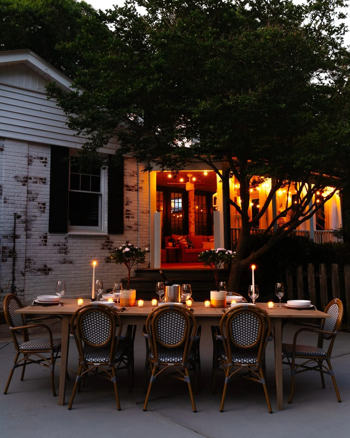 night time backyard patio and back porch with string lights and candlelight