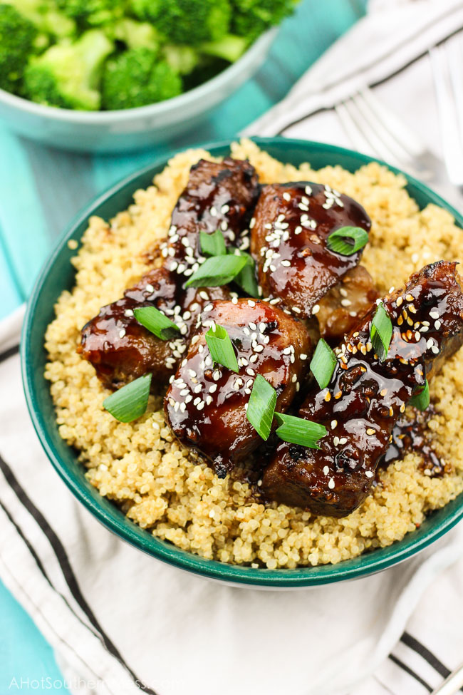Spicy sticky asian ribs are drizzled in sweet and spicy glaze, kissed to a slight crunch on the grill, and melt-in-your-mouth, incredibly tender on the inside. These pork ribs are finger-lickin' and slap yo mama silly kind of 'good'. www.ahotsouthernmess.com