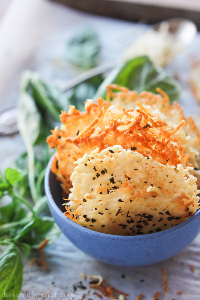 Garlic basil parmesan crisps are an easy 3 ingredient baked recipe! These great dippers are perfect appetizers or snacks for any gluten-free or low carb eaters and are huge hits at parties! All you need is parmesan, basil, garlic powder and 5 minutes beside your oven! www.blessherheartyall.com