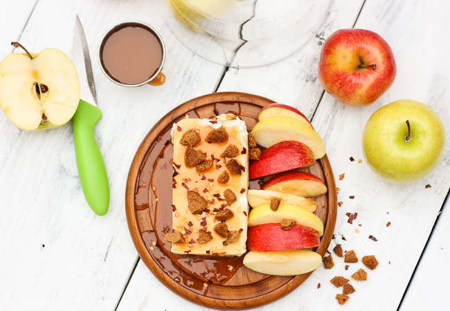 This Spicy Caramel Apple Dip is a 2-minute recipe that is both simple to make and easy to scarf down. Included in this recipe are healthier ingredients like greek yogurt and honey as well as a touch of spicy pepper, caramel drizzle, and gluten-free ginger snap crumbles, for a sweet and spicy, creamy and crunchy dip that's the perfect fall appetizer or treat for you and your hungry friends! www.blessherheartyall.com