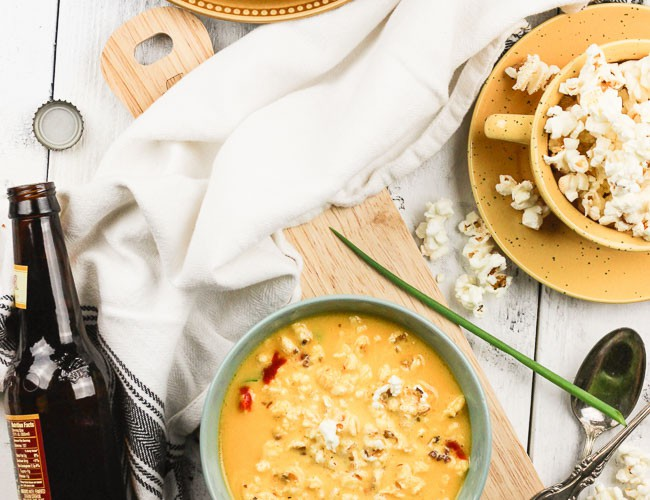 An easy gluten-free slow cooker recipe for beer cheese soup! Toss your ingredients in the crock pot and let it cook! www.blessherheartyall.com