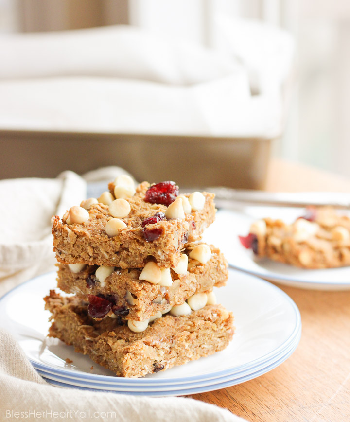 These gluten-free quinoa breakfast bars are a sweet and easy breakfast option for those on-the-go mornings. These breakfast / protein bars combine quinoa, coconut flour, honey, and peanut butter with dried fruits and white chocolate chips to make a delicious baked gluten-free breakfast! www.BlessHerHeartYall.com